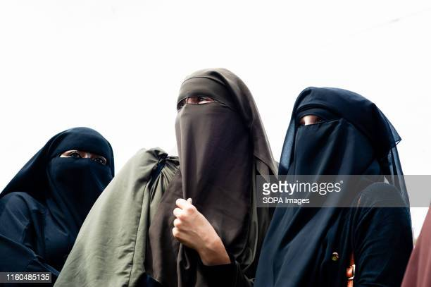 A group of women are seen wearing burqas take part during the protest Hundreds of people gathered in The Hague after The Netherlands approves a...