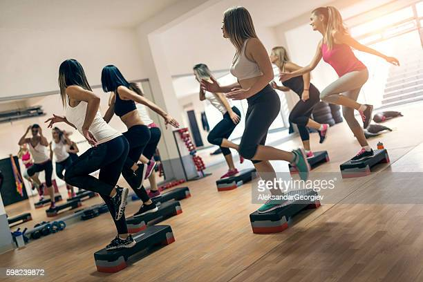 Group of Women at Aerobics Class Exercising In Gym
