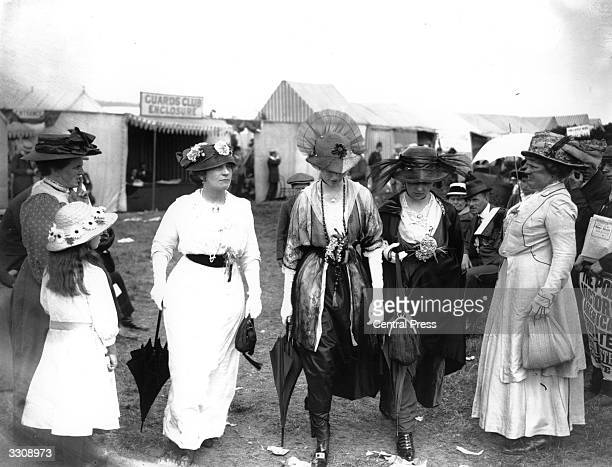 Group of women at Ascot wearing the latest fashions.