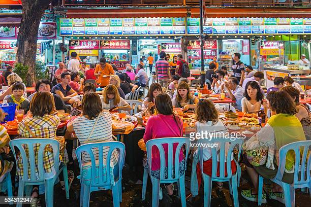 Group of women at crowded outdoor restaurant Kuala Lumpur Malaysia