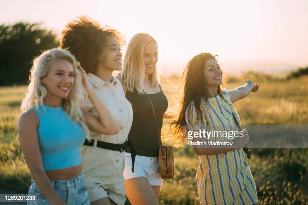 group of women at sunset - four people stock pictures, royalty-free photos & images