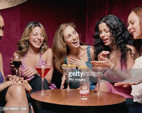 Group Of Women At Table Talking And Laughing Stock Photo