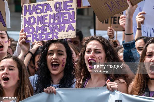 A group of women at the head of the demonstration are seen shouting slogans next to a sign with the text until they kill me they will not believe me...