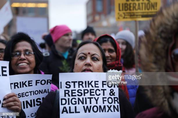 Group of women attend a rally and march in Washington Square Park for international Women's Day on March 8, 2018 in New York City. Around the world,...