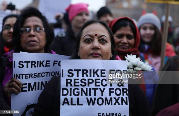 A group of women attend a rally and march in Washington Square Park for international Women's Day on March 8 2018 in New York City Around the world...