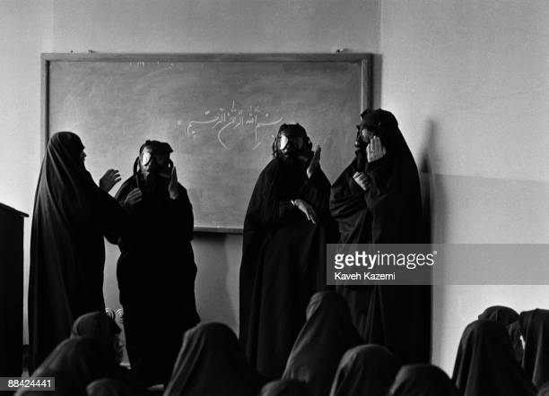 A group of women Basiji in a Tehran mosque learning to use gas masks in case of a chemical attack by Saddam Hussein's Iraq 11th May 1988 Towards the...