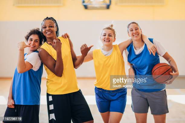 group of women basketball team - sports league stock pictures, royalty-free photos & images