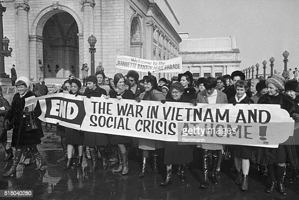 A group of women belonging to the Jeanette Rankin Brigade march in protest of the Vietnam War Jeanette Rankin the first female congress member stands...