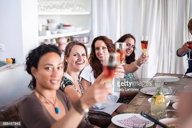 Group of women bringing out a toast