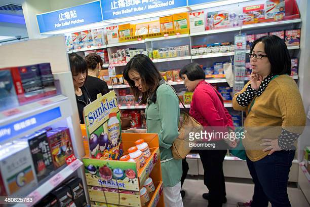 A group of women browse medicinal products in a Watsons store operated by AS Watson Co in the Tsim Sha Tsui district of Hong Kong China on Tuesday...
