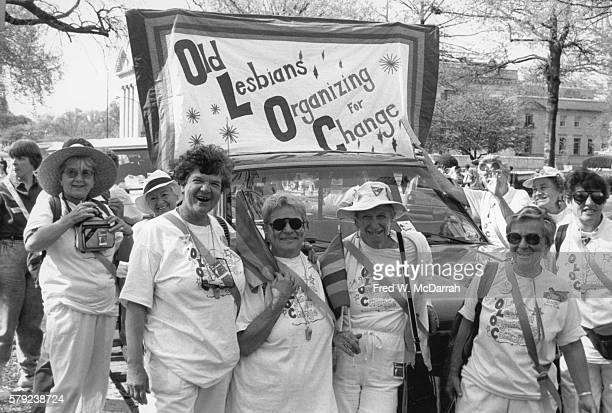 A group of women carry an OLOC banner during the March on Washington for Gay Lesbian and Bi Equal Rights and Liberation Washington DC April 25 1993