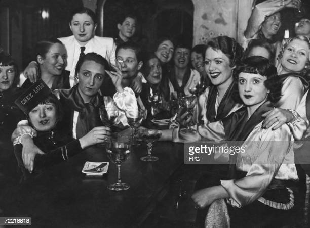 A group of women celebrate a reveillon in Paris circa 1925 A reveillon is a dinner party preceding Christmas and New Year at which luxury foods and...