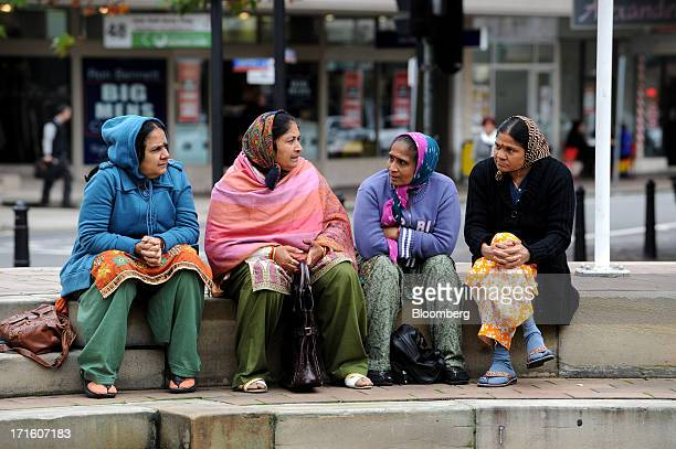 A group of women chat while sitting on some steps on Church Street mall in the suburb of Parramatta in western Sydney Australia on Monday June 24...