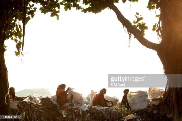 Group of women collecting plastic sitting in a garbage dump at Lalbag in the side of Buriganga River Dhaka