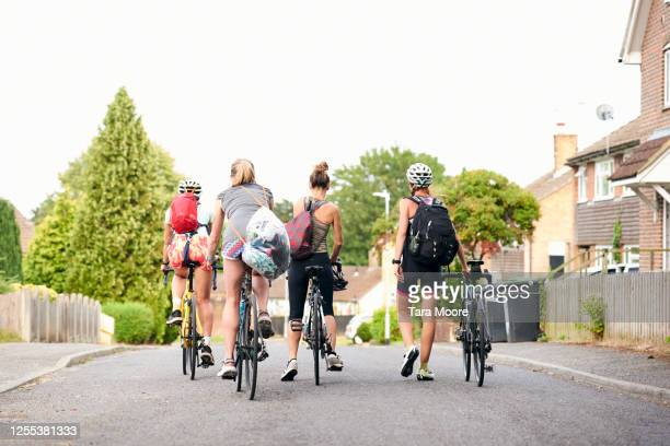 group of women cyclists on road - headwear stock pictures, royalty-free photos & images