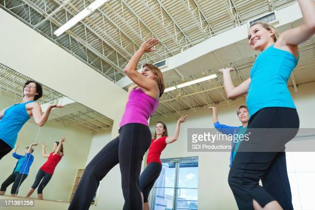 Group of women dancing in fitness exercise class