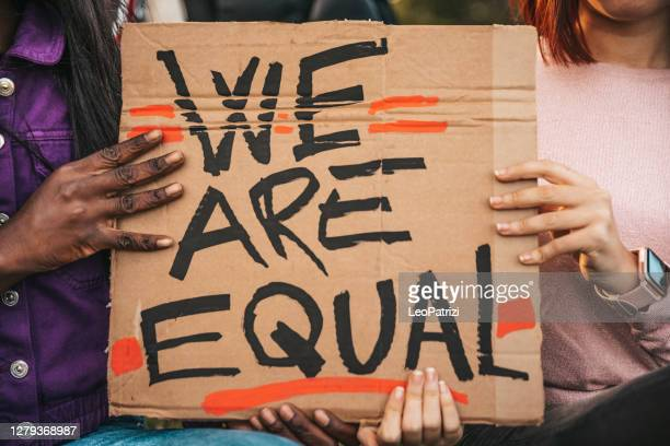 group of women demostrating fos social equity - black lives matter stock pictures, royalty-free photos & images