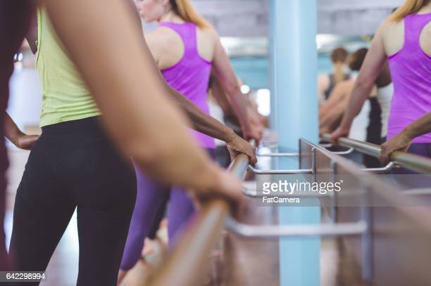 group of women doing barre + trx workout - isometric projection stock photos and pictures