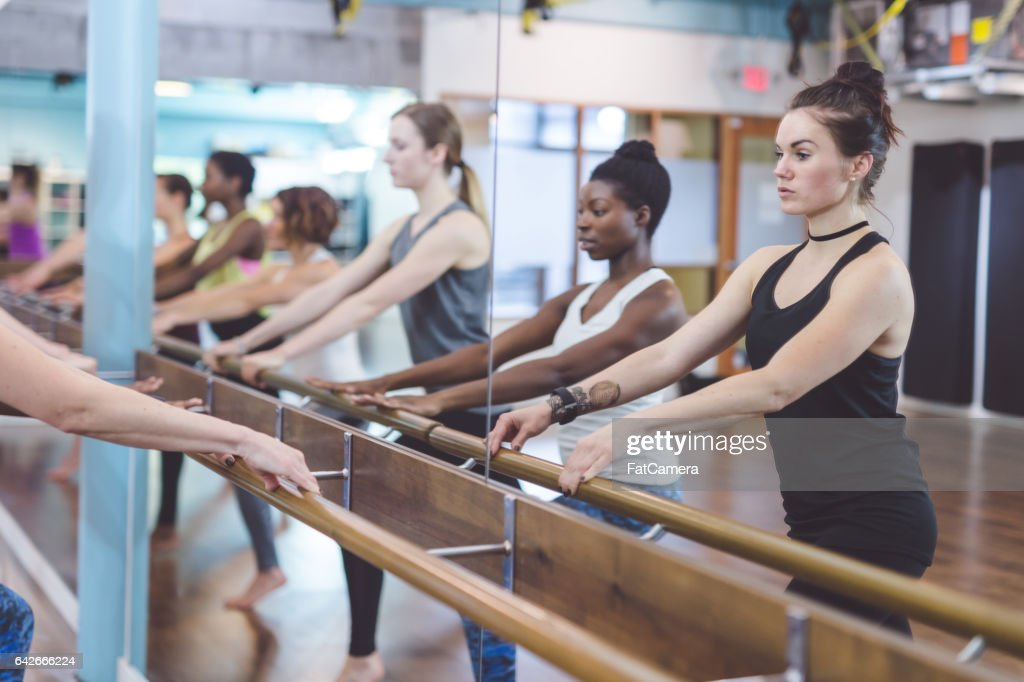 Group of Women Doing Barre + TRX Workout : Stock Photo