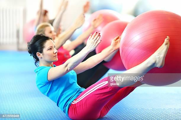 Group of women doing pilates.