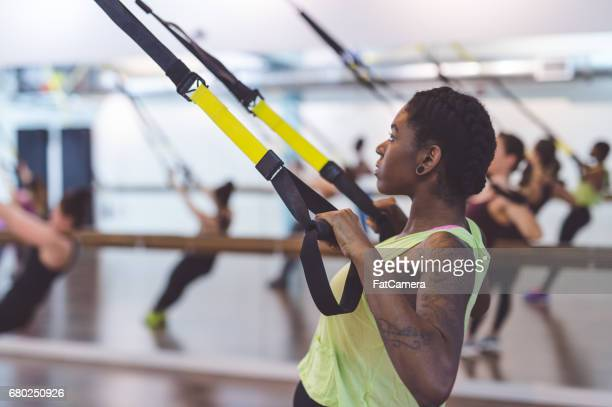 group of women doing trx workout - hair conditioner stock photos and pictures