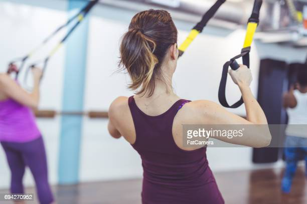 group of women doing trx workout - fat lady in leggings stock photos and pictures