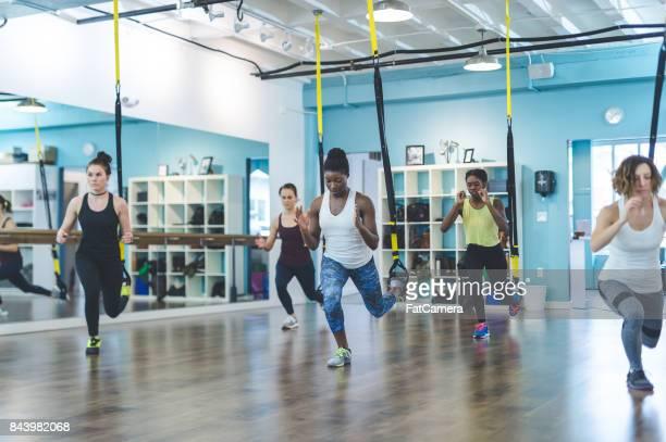 Group of Women Doing TRX Workout