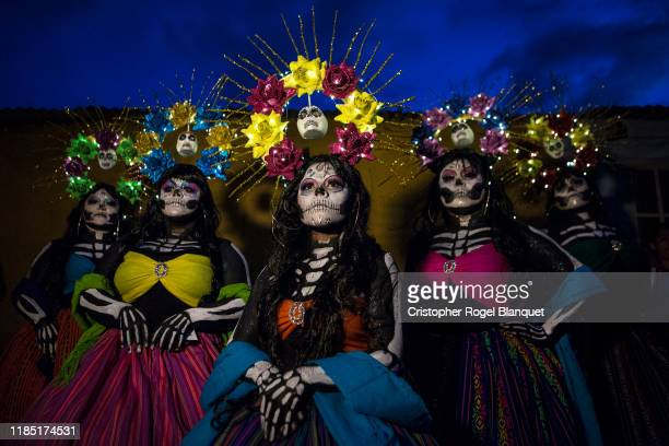 A group of women dressed as Catrinas pose as part of the 'Day of the Dead' celebrations on November 2 2019 in Oaxaca Mexico Every year people in...