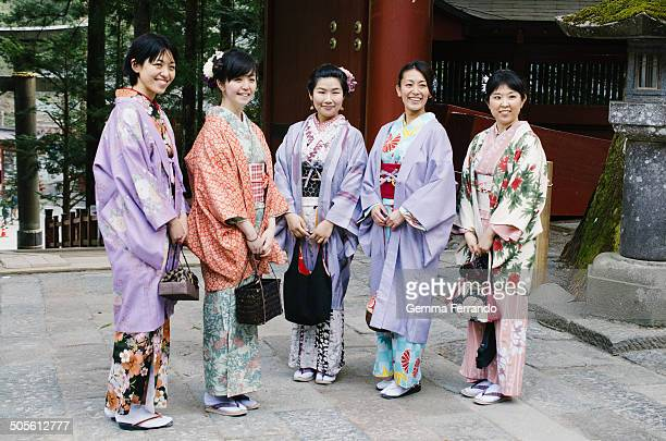 Group of women dressed in traditional kimono visiting a Japanese temple in Nikko, Japan. Nikko is famous for it's World Heritage shrines and temples,...