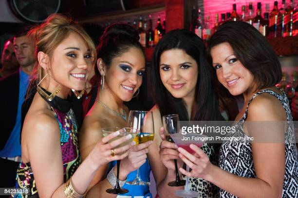 group of women drinking cocktails nightclub - beautiful puerto rican women stock photos and pictures