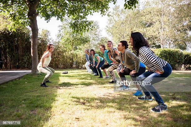 Group of women exercising in the garden