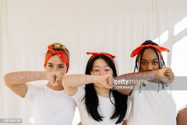 group of women fighting for women's rights.feminism and gender equality concept. - women's rights stock pictures, royalty-free photos & images