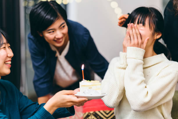group of women friends having birthday party at home - best friend birthday cake stock pictures, royalty-free photos & images