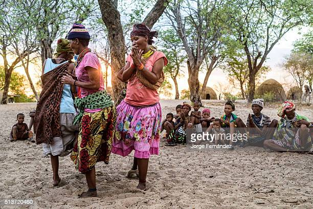 DESERT NAMIBIA TSUNKWE NAMIBIA Group of women from the San tribe playing a game in which they dance in circles with their legs banded together in a...