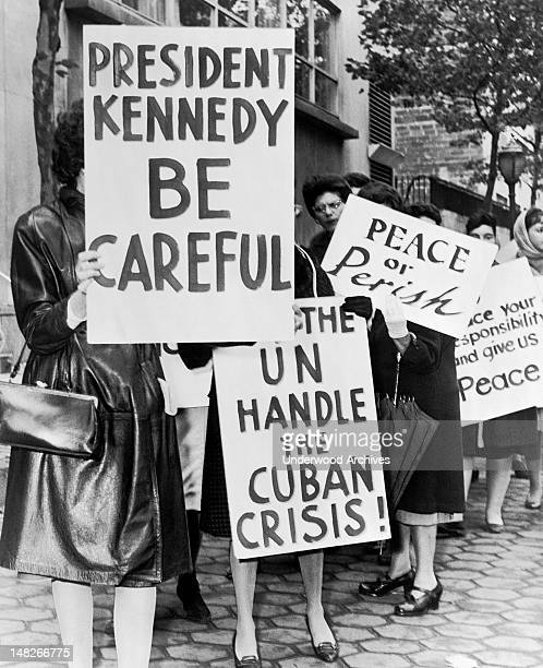 Group of women from Women Strike for Peace holding placards relating to the Cuban missile crisis and to peace, New York, New York, 1962. They were...