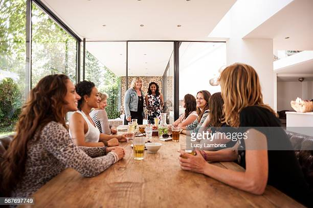 Group of women gathered at a table and laughing