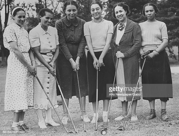 Group of women golfers holding golf clubs at the Wake Robin golf club, an African-American womens golf club in Washington DC, Washington DC, April 6,...