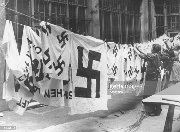 A group of women hanging freshly laundered Nazi banners out to dry