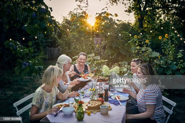 Group of women having dinner in garden