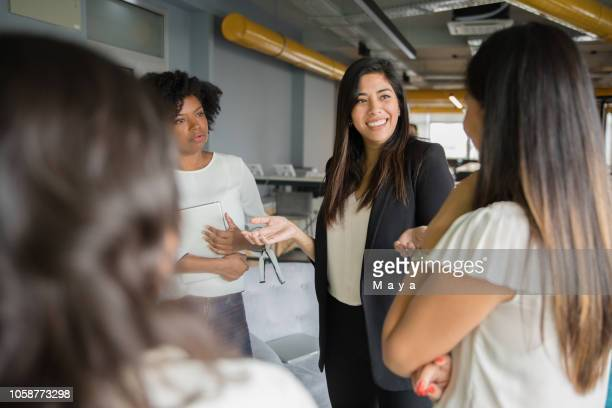 group of women having informal conversation - businesswoman stock pictures, royalty-free photos & images