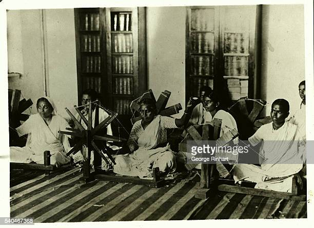 A group of women here are producing khaddar on spinning wheels with a view to boycott British goods This homeproduction movement launched by Gandhi...