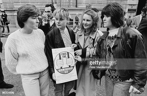 A group of women holding a poster published by the Campaign For The Birmingham Six 19th October 1989 They are outside the Old Bailey London as...