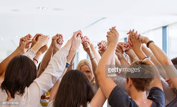 group of women holding hands. unity concept - only women stock pictures, royalty-free photos & images