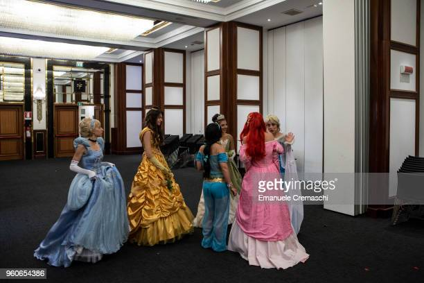 A group of women impersonating various Disney princesses characters attends the Italian Doll Convention on May 19 2018 in Milan Italy Italian Doll...