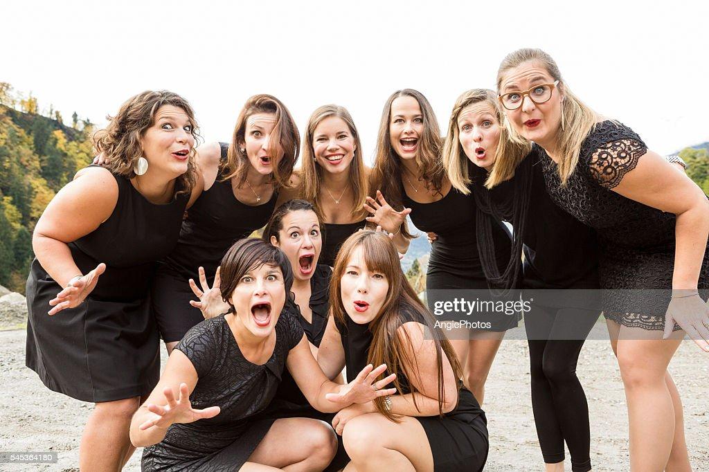 Group of women in black dress looking surprised : Stock Photo