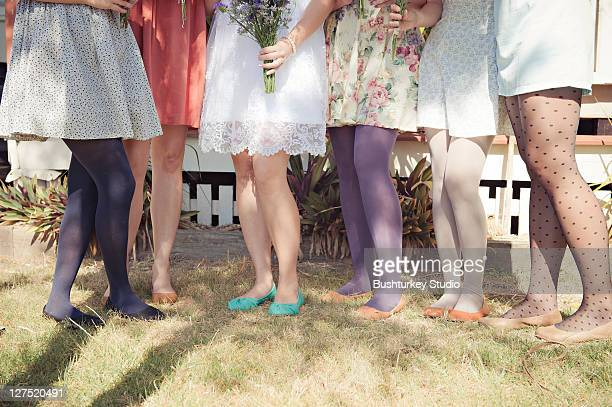 Group of women in colourful shoes and stockings