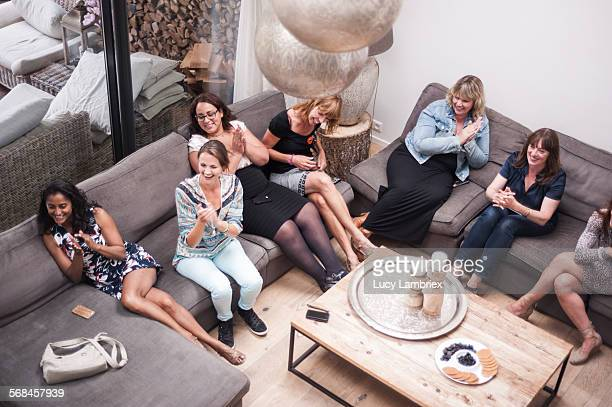 Group of women in living room, seen from above