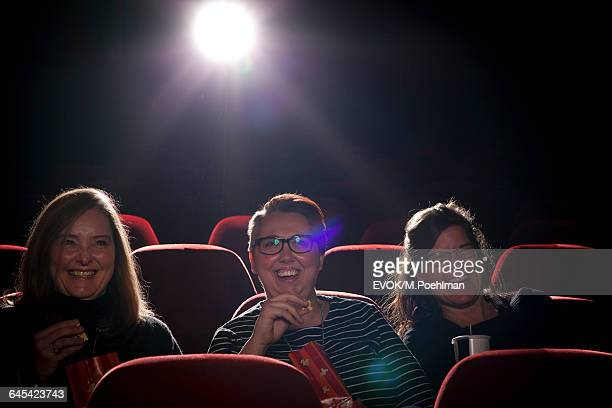 Group of women in movie theater watching a movie