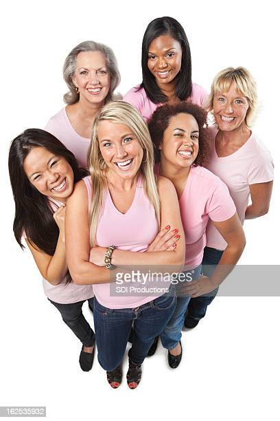 Group of women in pink shirts on white background