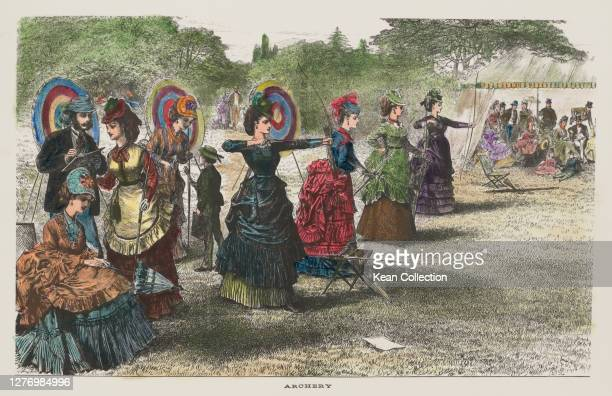 Group of women in Victorian fashions, some holding bows and arrows, with targets behind them, in a hand-coloured wood engraving, published in The...